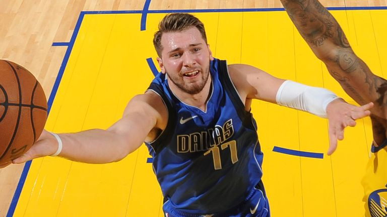 Luka Doncic attacks the basket against Golden State