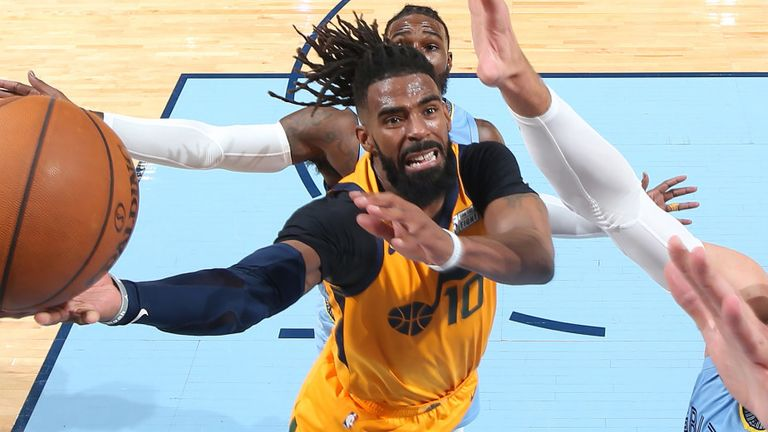 Mike Conley attacks the basket against his former team the Memphis Grizzlies