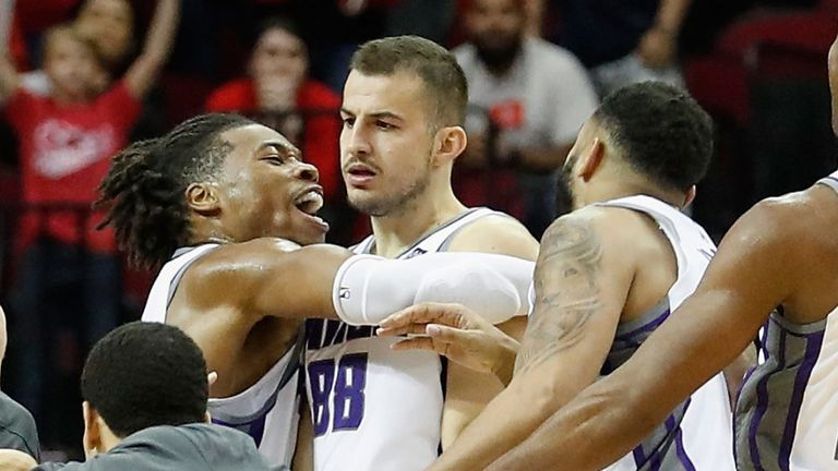 Nemanja Bjelica is mobbed by his team-mates after hitting a buzzer-beater to earn the Kings victory over the Rockets