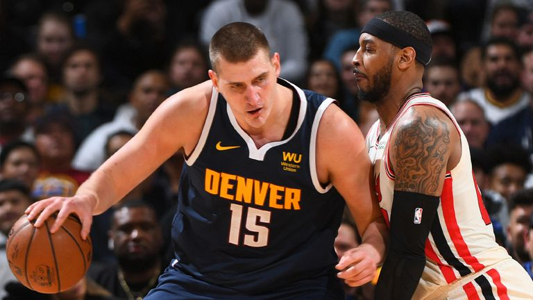 Nikola Jokic is guarded by Carmelo Anthony