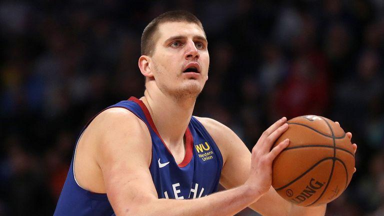 Nikola Jokic prepares to shoot a jump shot against the Timberwolves