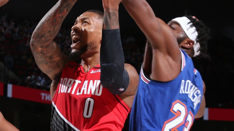 Damian Lillard drives to the hoop against New York