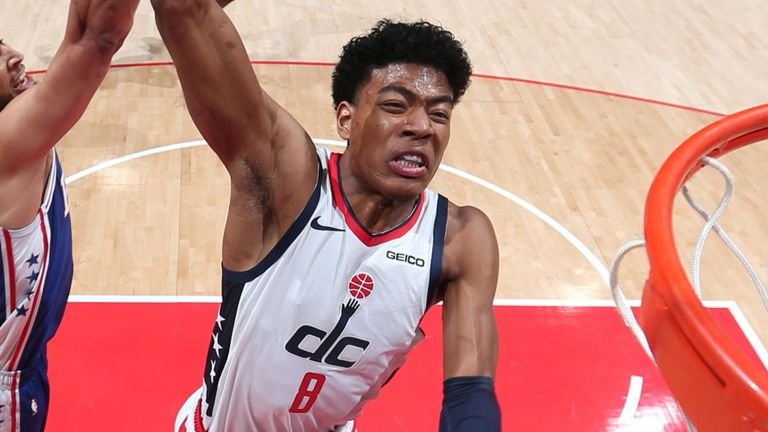Rui Hachimura rams home a dunk against the 76ers