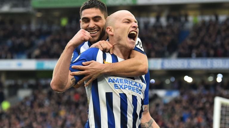 Aaron Mooy celebrates after doubling Brighton's lead