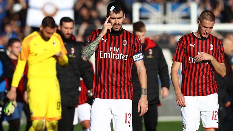 Alessio Romagnoli and Andrea Conti trudge off after AC Milan's heavy loss