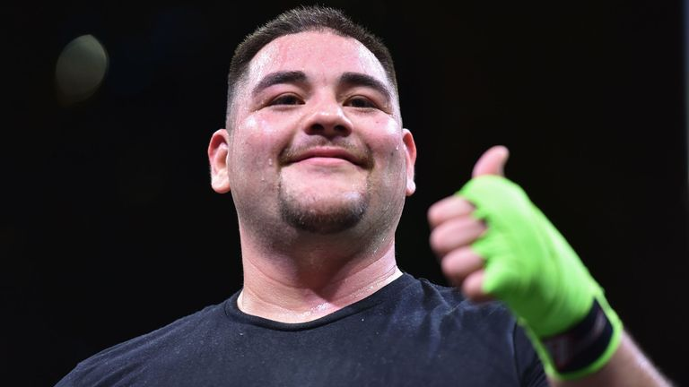 "Mexican-American heavyweight boxing champion Andy Ruiz Jr gestures as he arrives to a workout session at Digital City in the Saudi capital Riyadh, on December 3, 2019, ahead of the upcoming ""Clash on the Dunes"". - The hotly-anticipated rematch between Ruiz Jr and British challenger Anthony Joshua is scheduled to take place in Diriya, near the Saudi capital on December 7."