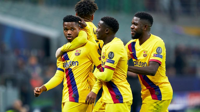 Barcelona players celebrate with team-mate Ansu Fati after his goal