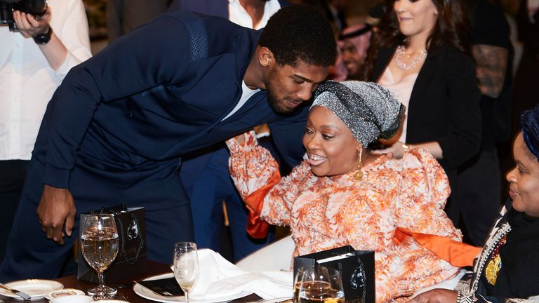 Anthony Joshua embraces his mother
