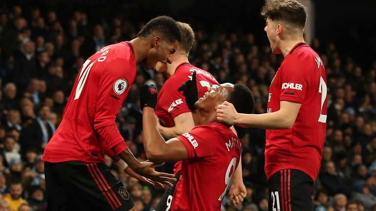 Anthony Martial celebrates doubling Manchester United's lead