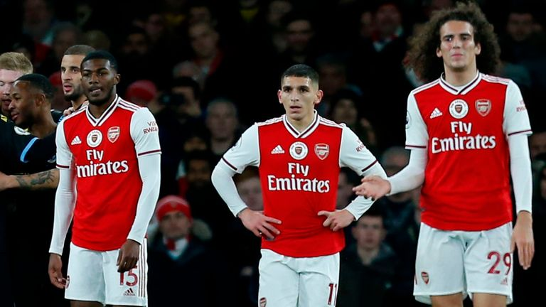 Arsenal players react after Manchester City's second goal