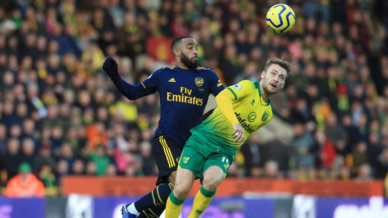 Arsenal's Alexandre Lacazette (L) vies with Norwich's Tom Trybull