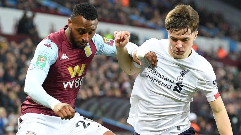 Aston Villa's Jonathan Kodija is challenged by Liverpool's Morgan Boyes