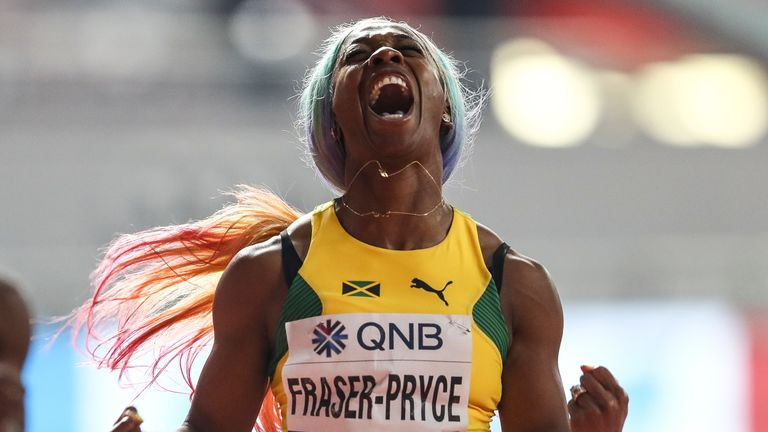 Fraser-Pryce celebrates after winning the women's 100m final at the 2019 World Athletics Championships in Doha