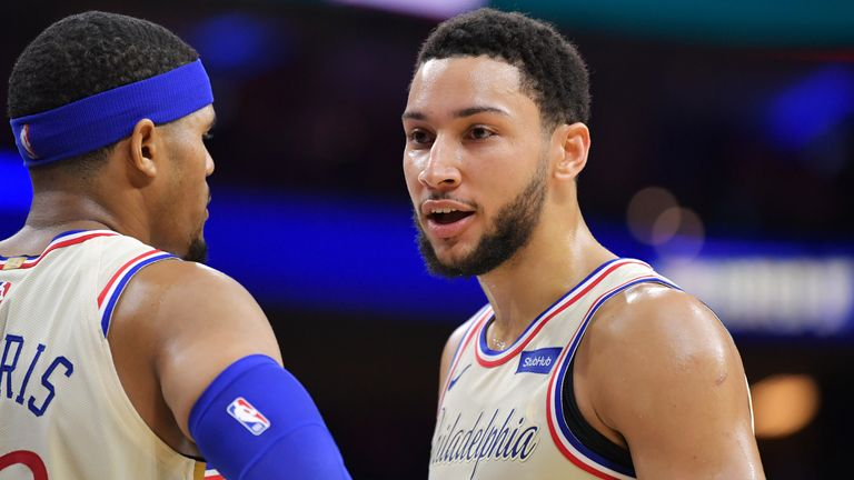 Ben Simmons of the Philadelphia 76ers talks with teammate Tobias Harris against the Cleveland Cavaliers