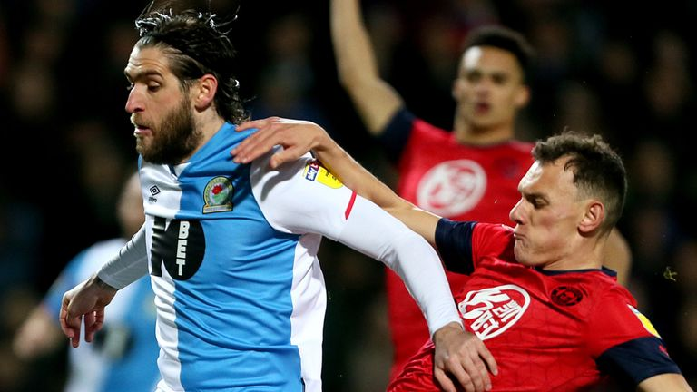 Danny Graham and Kal Naismith battle for the ball