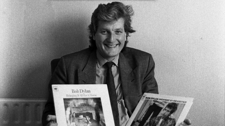 Bob Willis, English cricketer who played for Surrey, Warwickshire, and England, portrait holding Bob Dylan album , United Kingdom, 1990. (Photo by Martyn Goodacre/Getty Images)