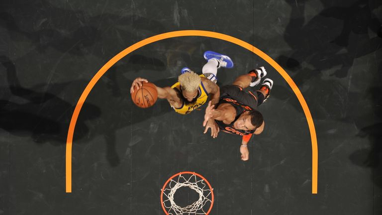Ky Bowman of the Golden State Warriors dunks the ball against the Orlando Magic