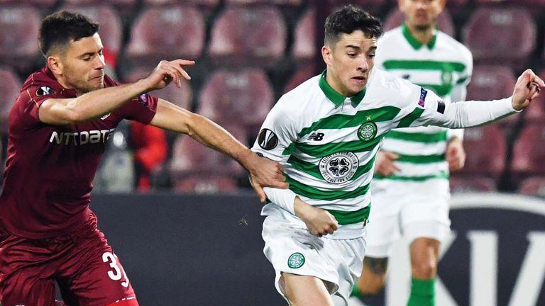 Celtic's Mikey Johnston battles with Cluj's Mihai Catalin Bordeianu
