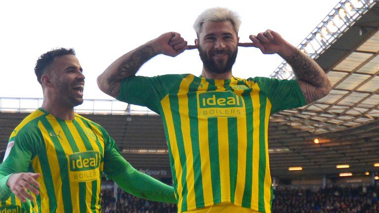 Charlie Austin celebrates scoring for West Brom against Birmingham