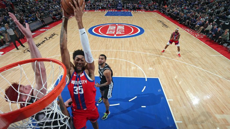 Christian Wood of the Detroit Pistons drives to the basket against the San Antonio Spurs