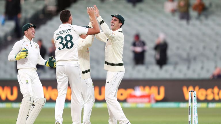Josh Hazlewood (C) and Pat Cummins celebrate the run-out of Mohammad Abbas that clinched Australia's victory in the second Test