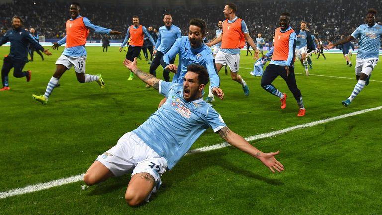 Danilo Cataldi slides in celebration after scoring Lazio's third goal