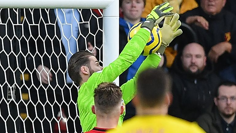 Manchester United's Spanish goalkeeper David de Gea fumbles a shot from Watford's Senegalese midfielder Ismaila Sarr into his own net during the English Premier League football match between Watford and Manchester United at Vicarage Road Stadium in Watford, north of London on December 22, 2019