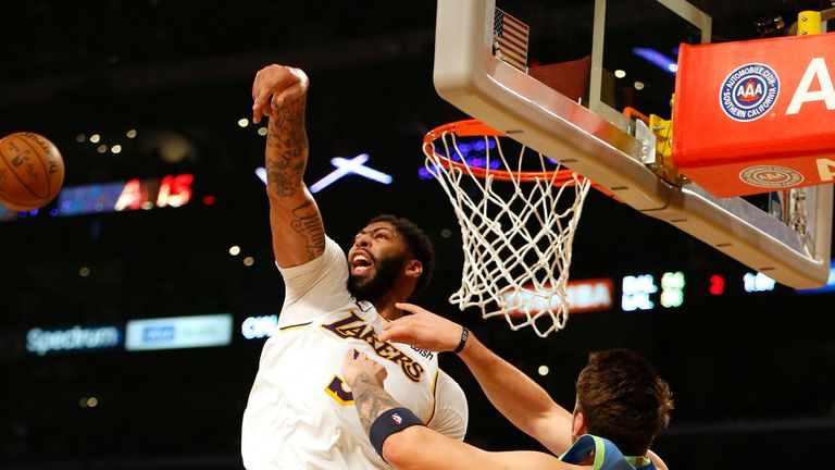 Anthony Davis of the Los Angeles Lakers swats away a shot by Luka Doncic of the Dallas Mavericks