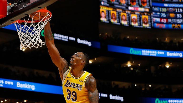 Dwight Howard of the Los Angeles Lakers dunks against the Atlanta Hawks