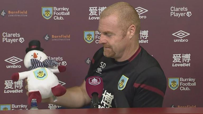 Sean Dyche holds up a snowman toy before his news conference