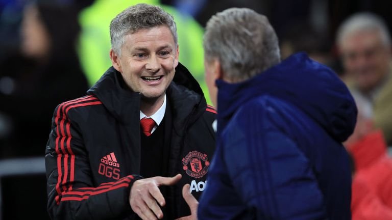 Ole Gunnar Solskjaer greets Cardiff manager Neil Warnock ahead of his first game in charge of Man Utd