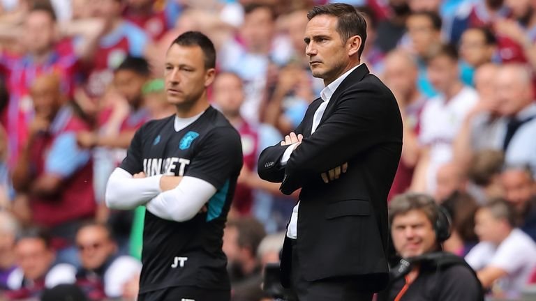 John Terry the Assistant Head Coach of Aston Villa stands on the touchline with Derby County manager \ head coach Frank Lampard the Sky Bet Championship Play-off Final match between Aston Villa and Derby County at Wembley Stadium on May 27, 2019 in London, United Kingdom.
