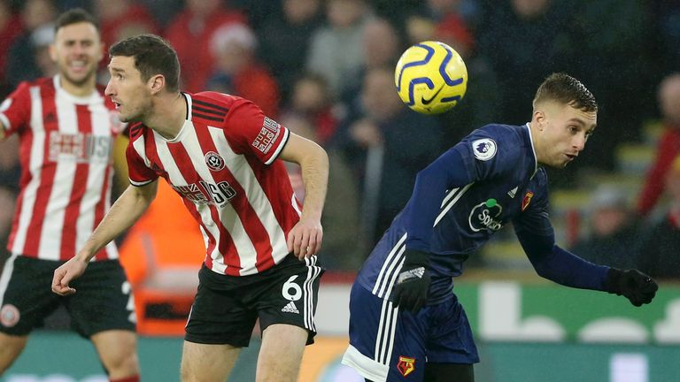 Gerard Deulofeu challenges for the ball with Chris Basham