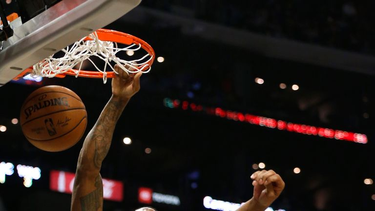 Kawhi Leonard of the Los Angeles Clippers dunks the ball as Rui Hachimura of the Washington Wizards