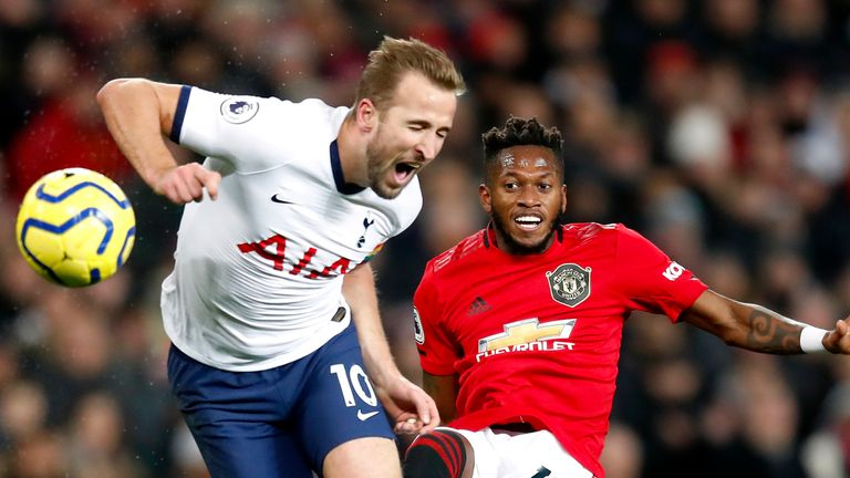 """Tottenham Hotspur's Harry Kane (left) and Manchester United's Fred battle for the ball during the Premier League match at Old Trafford, Manchester. PA Photo. Picture date: Wednesday December 4, 2019. See PA story SOCCER Man Utd. Photo credit should read: Martin Rickett/PA Wire. RESTRICTIONS: EDITORIAL USE ONLY No use with unauthorised audio, video, data, fixture lists, club/league logos or """"live"""" services. Online in-match use limited to 120 images, no video emulation. No use in betting, games or single club/league/player publications."""