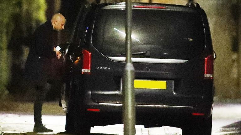 Arsenal's lawyer Huss Fahmy is pictured leaving Mikel Arteta's house