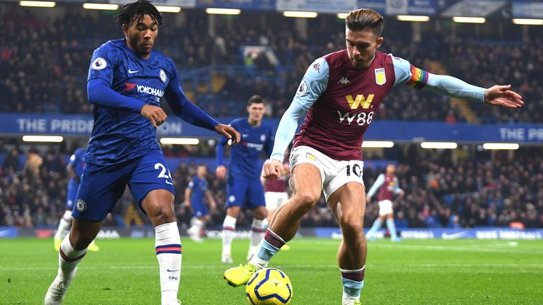 Jack Grealish controls the ball under pressure from Reece James