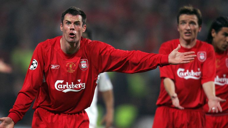Carragher gestures to his team-mates during the Champions League final