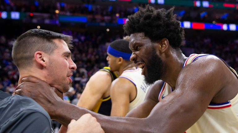 Joel Embiid  (right) jokingly embraces his former teammate T.J. McConnell of the Indiana Pacers  on Saturday