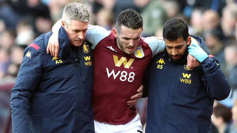 John McGinn hobbles off after picking up an injury in December