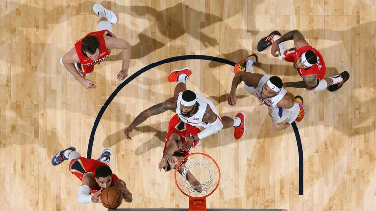 Josh Hart of the New Orleans Pelicans grabs the rebound against the Detroit Pistons