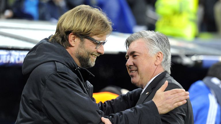 Dortmund's head coach Juergen Klopp (L) greets Real Madrid's Italian coach Carlo Ancelotti before the UEFA Champions League quarterfinal first leg football match Real Madrid FC vs Borussia Dortmund at the Santiago Bernabeu stadium in Madrid on April 2, 2014