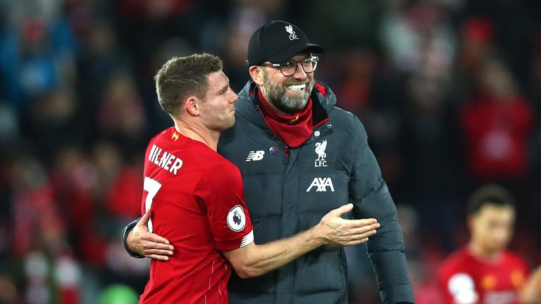 Jurgen Klopp and Milner embrace after the Merseyside derby win