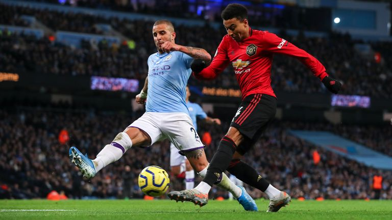 Kyle Walker tries to block an attempted cross from Jesse Lingard during the Manchester derby