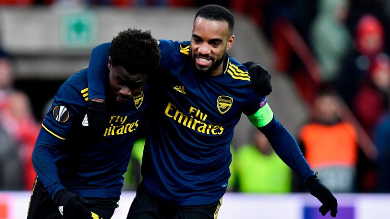 Alexandre Lacazette and Bukayo Saka scored as Arsenal came from two goals down to draw 2-2 in Liege