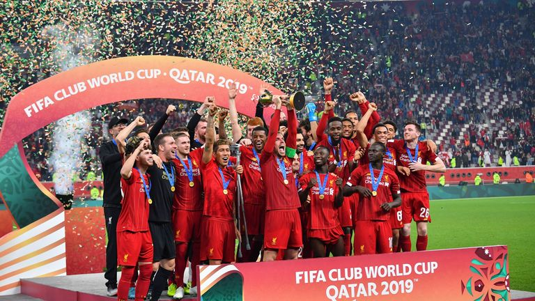 Liverpool lift the Club World Cup at the Khalifa International Stadium in Doha