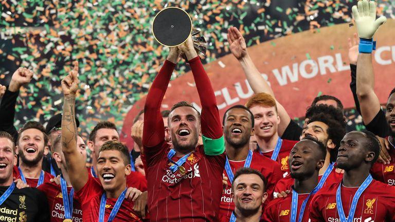 Liverpool captain Jordan Henderson lifts the Club World Cup trophy