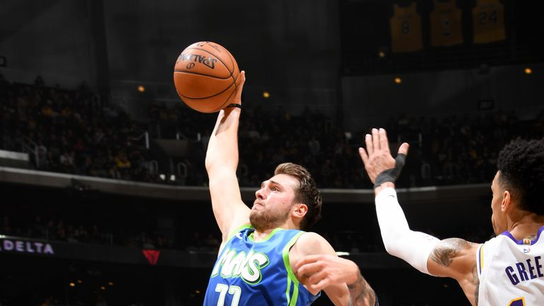 Luka Doncic of the Dallas Mavericks drives to the basket against the Los Angeles Lakers