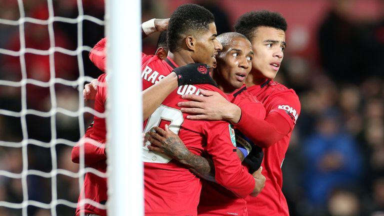 MANCHESTER, ENGLAND - DECEMBER 18: Marcus Rashford, Ashley Young and Mason Greenwood of Manchester United celebrate the third goal during the Carabao Cup Quarter Final match between Manchester United and Colchester United at Old Trafford on December 18, 2019 in Manchester, England. (Photo by John Peters/Manchester United via Getty Images)