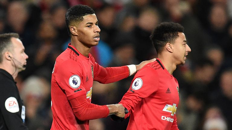 Manchester United's English striker Marcus Rashford (C) celebrates with Manchester United's English midfielder Jesse Lingard (R) after scoring their second goal from the penalty spot during the English Premier League football match between Manchester United and Tottenham Hotspur at Old Trafford in Manchester, north west England, on December 4, 2019.